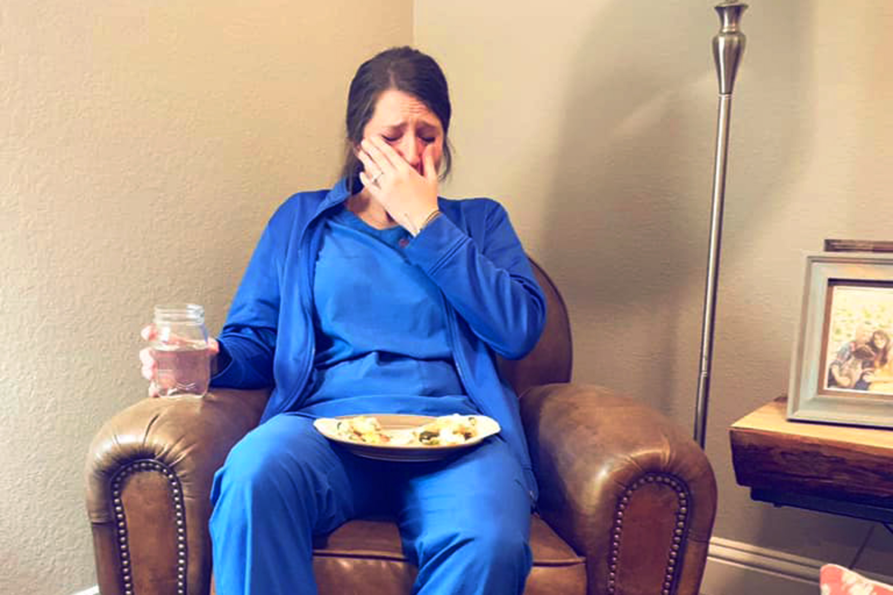 photo of nurse crying over dinner
